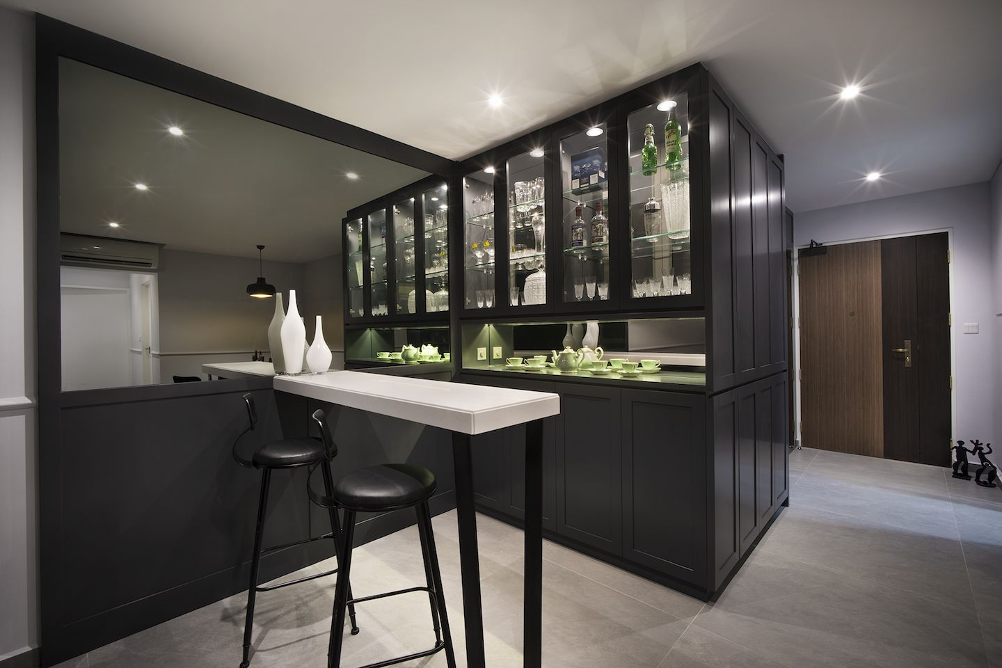 The Bar Area Glistens Just Off The Entrance, With A Custom Designed, Dark  Timber And Glass Fronted Display Cabinet. The Bar Area Is Completed With A  ...