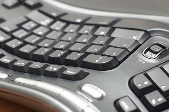 Well designed keyboards tilt away from the body and are angled according to the natural shape of the hands.