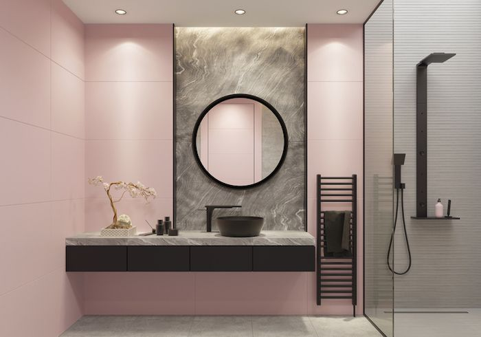 Black pairs with pink to create this unique, edgy bathroom design