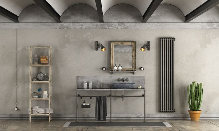 This masculine bathroom allows plumbing to remain exposed below the vanity, bringing the industrial look into the moment.