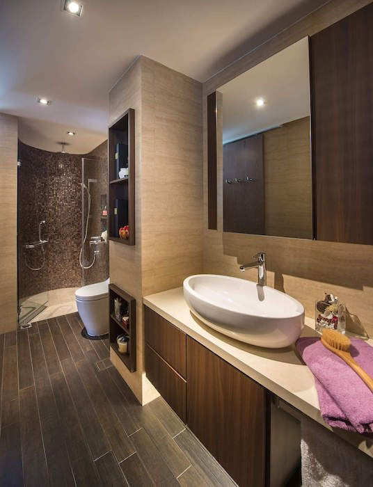 Recessed lighting and discreet cubby holes ensure this spa-inspired bathroom remains functional