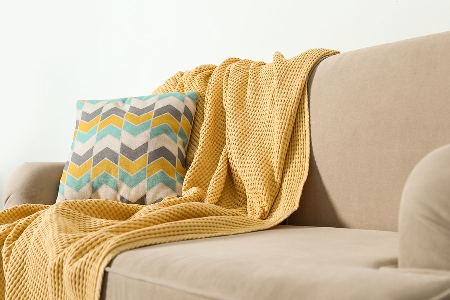 home interior design tip - Using Throws to decorate your sofa as a
